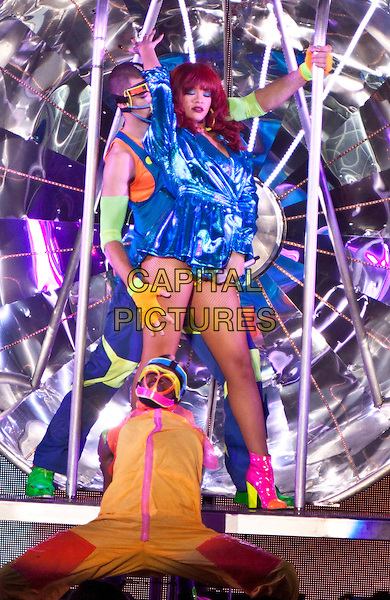 Rihanna (Robyn Rihanna Fenty).R&B superstar Rihanna made a stop on her LOUD tour at Chastain Park Amphitheater and performed for her enthusiastic fans Atlanta, GA, USA. .July 12th, 2011.stage concert live gig performance music full length red hair blue metallic dress jacket mac pink shoes boots arm in air backup dancers.CAP/ADM/DH.©Dan Harr/AdMedia/Capital Pictures.