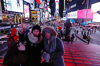 Tourists pose for a picture as they visit Times Square as the temperatures are set a record low in New York. 15.02.2015. Kena Betancur/VIEWpress.