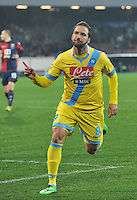 Gonzalo Higuain  celebrates after scoring   in action during the Italian Serie A soccer match between SSC Napoli and Genoa CFC   at San Paolo stadium in Naples, Feburary 24 , 2014