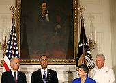United States President Barack Obama (C) speaks about the tornadoes that impacted Oklahoma yesterday, while joined by Vice President Joseph Biden (L) Homeland Security Secretary Janet Napolitano (2nd-R) and FEMA Deputy Administrator Richard Serino in the State Dining Room at the White House May 21, 2013 in Washington, DC. The town of Moore, Oklahoma reported a tornado to be at least EF4 strength and two miles wide that touched down Monday killing at least 24 people and leveling everything in its path. U.S. President Barack Obama promised federal aid to supplement state and local recovery efforts. .Credit: Mark Wilson / Pool via CNP