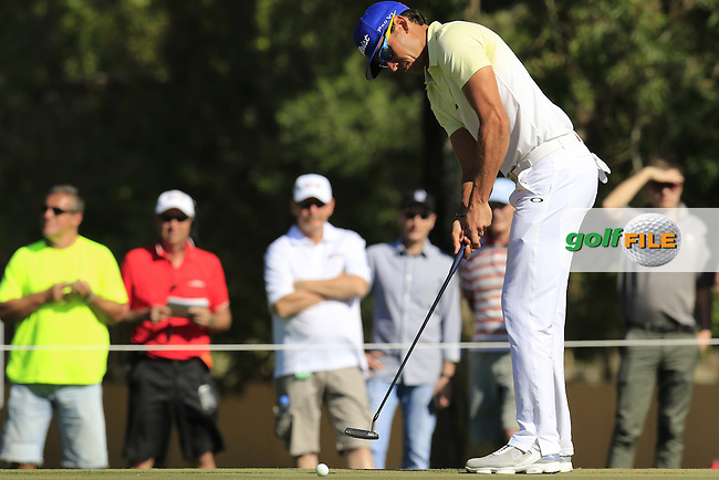 Rafa Cabrera-Bello (ESP) takes his putt on the 10th green during Sunday's Final Round of the 2016 Omega Dubai Desert Classic held at the Emirates Golf Club, Dubai. 7th February 2016.<br /> Picture: Eoin Clarke | Golffile<br /> <br /> <br /> All photos usage must carry mandatory copyright credit (&copy; Golffile | Eoin Clarke)