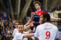 06 APR 2012 - LONDON, GBR - Great Britain's Gawain Vincent (GBR) (top, in blue and red) and the Tunisian defenders watches as he scores during the men's 2012 London Cup match at the National Sports Centre in Crystal Palace, Great Britain .(PHOTO (C) 2012 NIGEL FARROW)