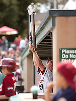 STANFORD, CA - May 22, 2011: Dean McArdle of Stanford baseball leads a clapping cheer with his hand extensions during Stanford's game against Arizona at Sunken Diamond. Stanford won 2-1.