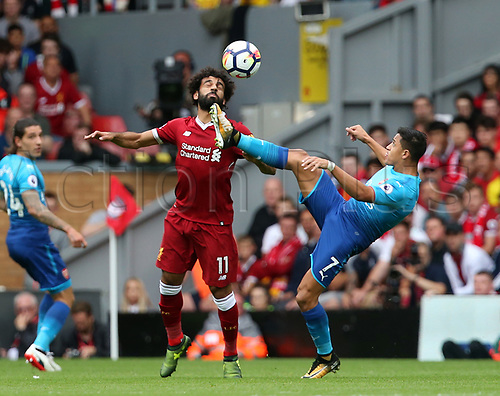 27th August 2017, Anfield, Liverpool, England; EPL Premier League football, Liverpool versus Arsenal; Alexis Sanchez of Arsenal raises his boot to dispossess Mohammed Salah of Liverpool