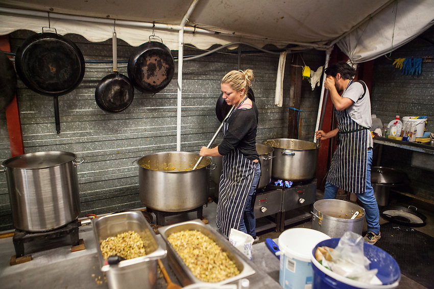 """Help Refugeess UK Volunteers cooking and preparing food for the refugees at """"The Jungle"""" refugee camp in Calais. Help Refugees has grown out of #helpcalais, a social media campaign started by Lliana Bird (Radio X DJ), Dawn O'Porter (Writer and Presenter), Josie Naughton and Heydon Prowse (The Revolution will be Televised) to raise a few funds and collect goods to take to Calais to help in some small way. The public response to the campaign was huge, and we were quickly able to provide aid in Calais and far beyond."""