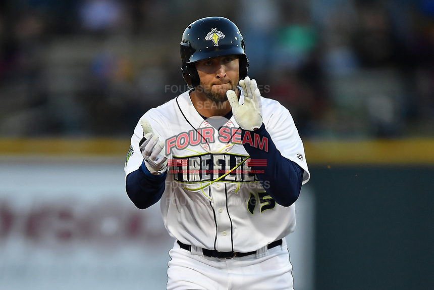 Left fielder Tim Tebow (15) of the Columbia Fireflies claps his hands rounding second after hitting a home run in his first Class A at bat in a game against the Augusta GreenJackets on Opening Day, Thursday, April 6, 2017, at Spirit Communications Park in Columbia, South Carolina. (Tom Priddy/Four Seam Images)
