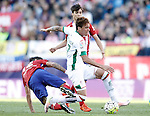 Atletico de Madrid's Augusto Fernandez (l) and Oliver Torres (b) and Granada Club de Futbol's Adalberto Penaranda during La Liga match. April 17,2016. (ALTERPHOTOS/Acero)