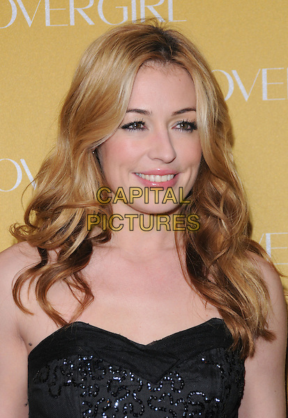 CAT DEELEY .at The Covergirl 50th Anniversary Celebration held at BOA in West Hollywood, California, USA, .January 5th 2011..portrait headshot  black strapless beaded sparkly smiling make-up wavy hair beauty                            .CAP/RKE/DVS.©DVS/RockinExposures/Capital Pictures.