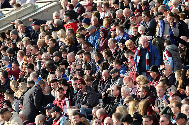 Burnley fans enjoy the second half action<br /> <br /> Photographer Rich Linley/CameraSport<br /> <br /> The Premier League - Burnley v Wolverhampton Wanderers - Saturday 30th March 2019 - Turf Moor - Burnley<br /> <br /> World Copyright © 2019 CameraSport. All rights reserved. 43 Linden Ave. Countesthorpe. Leicester. England. LE8 5PG - Tel: +44 (0) 116 277 4147 - admin@camerasport.com - www.camerasport.com