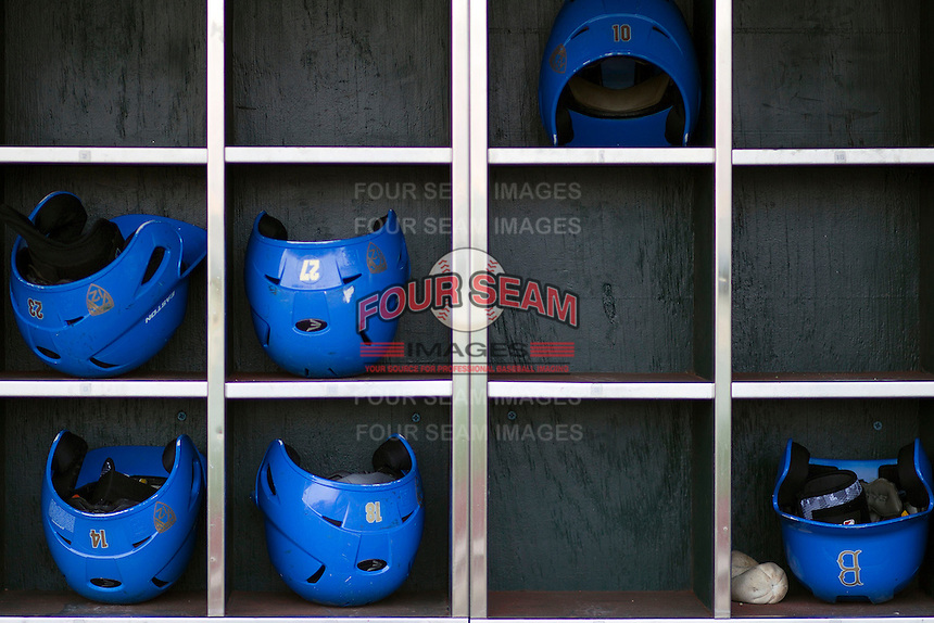 UCLA helmets before Game 1 of the 2013 Men's College World Series Finals against the Mississippi State Bulldogs on June 24, 2013 at TD Ameritrade Park in Omaha, Nebraska. The Bruins defeated the Bulldogs 3-1, taking a 1-0 lead in the best of 3 series. (Andrew Woolley/Four Seam Images)