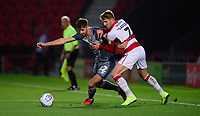 Lincoln City's Ellis Chapman vies for possession with Doncaster Rovers' Kieran Sadlier<br /> <br /> Photographer Andrew Vaughan/CameraSport<br /> <br /> EFL Leasing.com Trophy - Northern Section - Group H - Doncaster Rovers v Lincoln City - Tuesday 3rd September 2019 - Keepmoat Stadium - Doncaster<br />  <br /> World Copyright © 2018 CameraSport. All rights reserved. 43 Linden Ave. Countesthorpe. Leicester. England. LE8 5PG - Tel: +44 (0) 116 277 4147 - admin@camerasport.com - www.camerasport.com