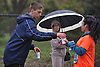 Chris Putnam of Massapequa hands out water on Merrick Avenue for Long Island Marathon runners on Sunday, May 1, 2016.