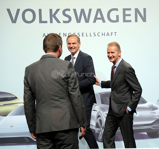 03 May 2018, Germany, Berlin: Herbert Diess, CEOof Volkswagen AG (R)and Oliver Blume, CEOof Porsche AG, in conversation at the Volkswagen AG annual general meetingat the Messegelaende in Berlin. Photo: Wolfgang Kumm/dpa /MediaPunch ***FOR USA ONLY***