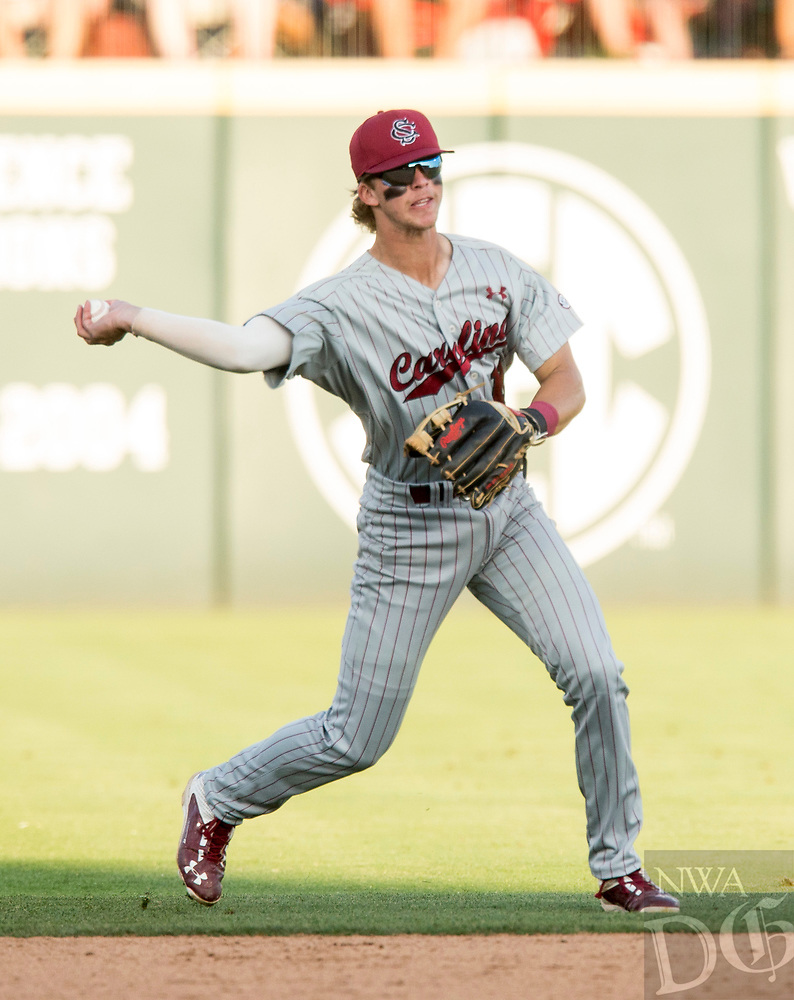 NWA Democrat-Gazette/BEN GOFF @NWABENGOFF<br /> LT Tolbert, South Carolina shortstop, bobbles a ground ball off an Arkansas bat in the 4th inning Saturday, June 9, 2018, during game one of the NCAA Super Regional at Baum Stadium in Fayetteville.