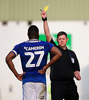 Macclesfield Town's Nathan Cameron is shown a yellow card by referee Brett Huxtable<br /> <br /> Photographer Chris Vaughan/CameraSport<br /> <br /> The EFL Sky Bet League Two - Lincoln City v Macclesfield Town - Saturday 30th March 2019 - Sincil Bank - Lincoln<br /> <br /> World Copyright © 2019 CameraSport. All rights reserved. 43 Linden Ave. Countesthorpe. Leicester. England. LE8 5PG - Tel: +44 (0) 116 277 4147 - admin@camerasport.com - www.camerasport.com