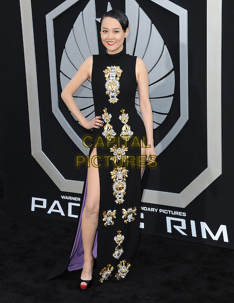Rinko Kikuchi<br /> &quot;Pacific Rim&quot; Los Angeles Premiere held at the Dolby Theatre, Hollywood, California, USA. <br /> July 9th, 2013<br /> full length black dress sleeveless slit split gold silver embellished jewel encrusted hand on hip <br /> CAP/DVS<br /> &copy;DVS/Capital Pictures