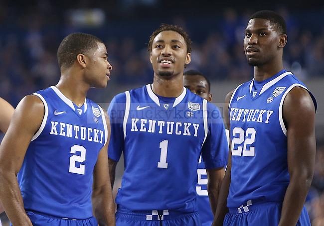 Kentucky Wildcats guard Aaron Harrison (2), guard/forward James Young (1), and forward Alex Poythress (22) talk during a time out during the NCAA Final Four vs. Wisconsin at the AT&T in Arlington, Tx., on Saturday, April 5, 2014. Photo by Emily Wuetcher | Staff