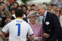 Her Majesty the Queen and Arnaud M. Bamberger, Executive Chairman present Aiyawatt Srivaddhanaprabha (King Power Foxes) with his award during the Cartier Queens Cup Final match between King Power Foxes and Dubai Polo Team at the Guards Polo Club, Smith's Lawn, Windsor, England on 14 June 2015. Photo by Andy Rowland.