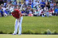 Stephen Gallacher (SCO) takes his putt on the 18th green during Friday's Round 2 of the 2014 Irish Open held at Fota Island Resort, Cork, Ireland. 20th June 2014.<br /> Picture: Eoin Clarke www.golffile.ie