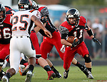BRANDON, SD - SEPTEMBER 26: Riley Frantzen #11 from Brandon Valley looks for running room as Michael Enalls #25 from Washington closes in during the first quarter of their game Friday night in Brandon.  (Photo by Dave Eggen/Inertia)