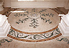 Custom bath floor medallion with vine accents.<br />