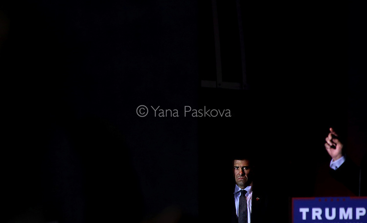 (L-R) A Secret Service agent surveys the crowd as U.S. Presidential candidate Donald Trump (R-NY) speaks at a rally at Sunset Cove Amphitheater in Boca Raton, FL, on March 13, 2016.<br /> <br /> Photo by: Yana Paskova