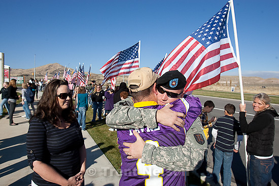 Trent Nelson  |  The Salt Lake Tribune.SFC Mike Jones, Utah National Guard, embraces his friend Jeff Malo, after returning home to Eagle Mountain. Family, friends and neighbors lined the streets of Eagle Mountain to welcome Jones home Friday, November 12, 2010. On his fourth deployment, Jones was injured in Afghanistan in September. Jones' wife Kindra Jones is at left.