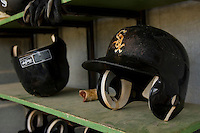 White Sox batting helmets in the Kannapolis Intimidators dugout at Fieldcrest Cannon Stadium July 10, 2009 in Kannapolis, North Carolina. (Photo by Brian Westerholt / Four Seam Images)