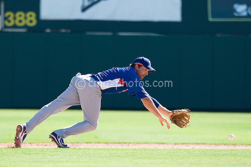 Mar 21, 2008; Tucson, AZ, USA;  Chicago Cubs third baseman Mark DeRosa (7) dives for a ball in the bottom of the 8th inning during a game against the Colorado Rockies at Hi Corbett Field.