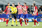 Atletico de Madrid's Yannick Ferreira Carrasco, Diego Godin, Stefan Savic and Filipe Luis have words with the English referee Mark Clattenburg during UEFA Champions League 2015/2016 Final match.May 28,2016. (ALTERPHOTOS/Acero)