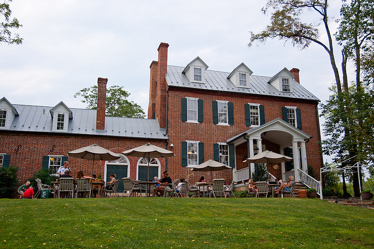 Groups and families enjoy picnics and wine on the front patio at The Winery at La Grange.