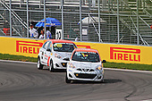a couple of Nissan Micras battle it out at the hairpin corner of the Circuit Gillles-Villeneuve during the Grand Prix of Canada on the 7th of June at Circuit Gilles-Villeneuve
