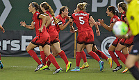 Portland, Oregon - Saturday July 9, 2016: Portland Thorns FC defender Kat Williamson (5) celebrates scoring with teammates during a regular season National Women's Soccer League (NWSL) match at Providence Park.