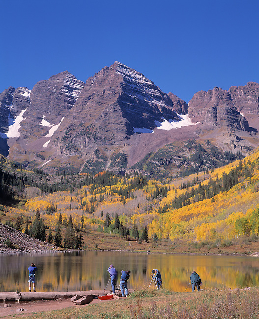 A group of photographers taking pictures of Maroon Bells above Maroon Lake in White River National Forest, Colorado