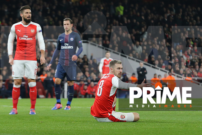Aaron Ramsey of Arsenal (right) looks to the Assistant as his penalty appeal is turned down by the referee during the UEFA Champions League match between Arsenal and Paris Saint Germain at the Emirates Stadium, London, England on 23 November 2016. Photo by David Horn.