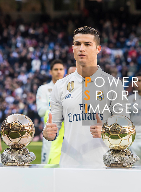 Cristiano Ronaldo of Real Madrid shows his fourth Golden Ball prior to the La Liga match between Real Madrid and Granada CF at the Santiago Bernabeu Stadium on 07 January 2017 in Madrid, Spain. Photo by Diego Gonzalez Souto / Power Sport Images