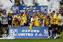 Oxford United players celebrate with the trophy after victory in the Blue Square Premier play-off final between Oxford United and York City at Wembley Stadium, London on 16th May,2010.© Kevin Coleman 2010