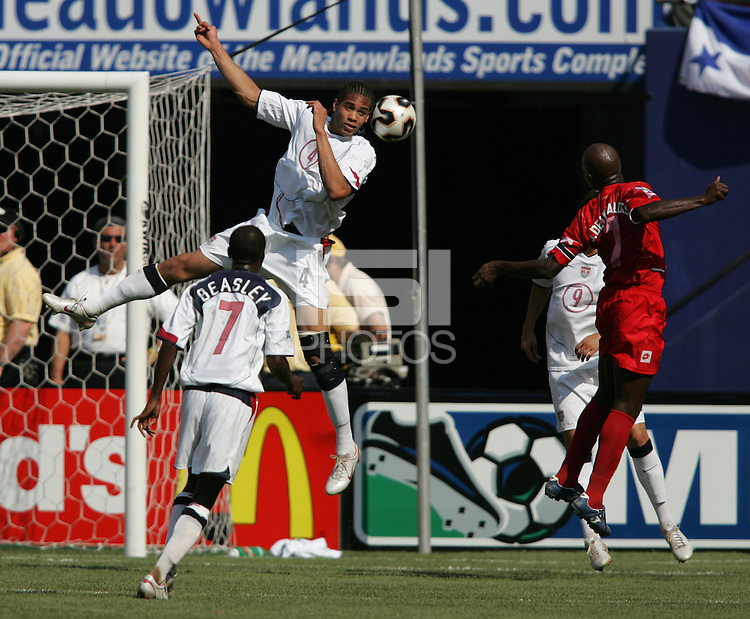 July 24, 2005: East Rutherford, NJ, USA: USMNT defender Oguchi Onyewu (4) heads the ball out of the box and away from Panama's forwards during the CONCACAF Gold Cup Finals at Giants Stadium.