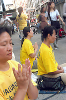 (040831-SWR4450) 31 August 2004 - New York, NY A BUDDDHIST RESPONSE TO WAR - Practioners of Falun Gong,9 Falun Dafa   0 mediate ib the corner of Houston Street and Broadway, in the Soho section of New York... Stacy Walsh Rosenstock