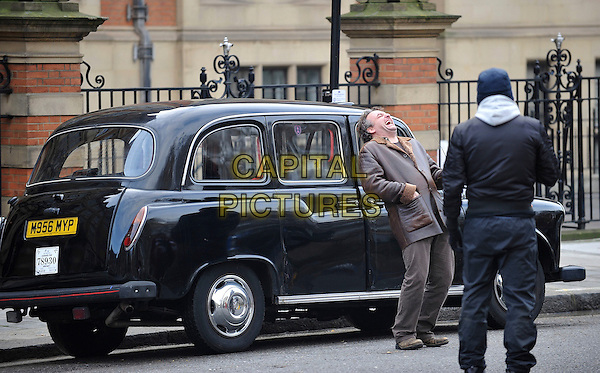 "*Exclusive*.MARCO RIMA.Seen filming ""Die Liebling"", a swiss feature film, Lincoln Inn, London, England, UK, December 16th 2009..full length filmset film set brown leather jacket black cab taxi coat laughing funny .CAP/IA.©Ian Allis/Capital Pictures."