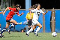 2 October 2011:  FIU's Ashleigh Shim (9) takes the ball to the goal while being pursued by South Alabama's Tatum Perry (20) in the second half as the FIU Golden Panthers defeated the University of South Alabama Jaguars, 2-0, at University Park Stadium in Miami, Florida.