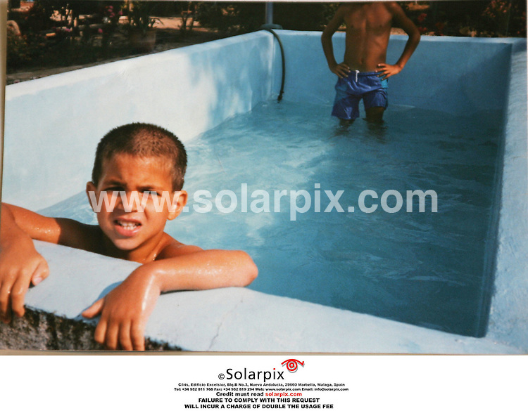 EXCLUSIVE PICTURES FROM SOLARPIX.COM.MUST CREDIT SOLARPIX.COM OR DOUBLE FEE INCURRED.The arsenal football player Francesc fabregas shown here with his family his farther by the same name and his sister Carlota and his cousins, there is the only picture of Francesc Fabregas and his girlfriend Carla DoÐa at a water park near Barcelona she is pictured far right with Fabregas and his farther and sister accompanied by a hippopotamus in pink..This picture shows:Fabregas in his swimming pool at home..DATE:31.03.06-JOB REF:2220-MER
