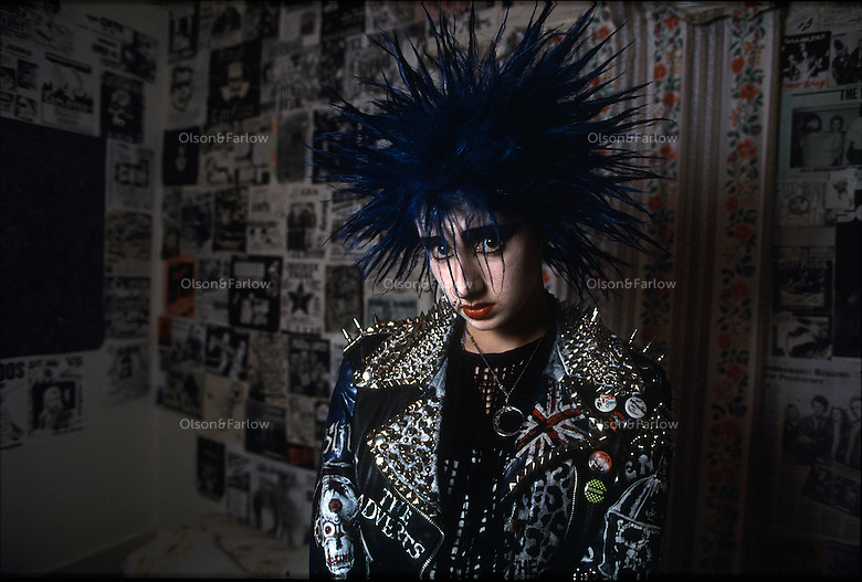 Portrait of a young woman dressed to go out with her friends on Saturday night with newly dyed blue spiked hair and a studded jacket