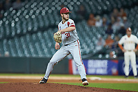 Arkansas Razorbacks relief pitcher Caleb Bolden (31) in action against the Texas Longhorns in game six of the 2020 Shriners Hospitals for Children College Classic at Minute Maid Park on February 28, 2020 in Houston, Texas. The Longhorns defeated the Razorbacks 8-7. (Brian Westerholt/Four Seam Images)