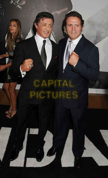 """Sylvester Stallone, Frank Stallone.""""The Expendables 2"""" Los Angeles Premiere held at Grauman's Chinese Theatre, Los Angeles, California, USA..August 15th, 2012.full length silver tie hand fists brothers siblings family white shirt black suit .CAP/ROT/TM.©Tony Michaels/Roth Stock/Capital Pictures"""