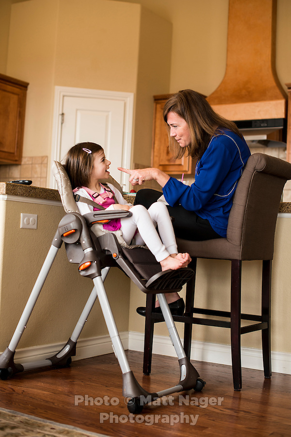 Liz Gorman (cq), sits with her daughter Madeline Gorman (cq, age 8), at their home in Colorado Springs, Colorado, Friday, April 10, 2015. Madeline uses the Charlotte's Web strain of CBD high marijuana to help lessen her seizures and also help with pain. Also photographed is Sarah Cantin (cq), a tutor with Alpine Autism Center.<br /> <br /> Photo by Matt Nager