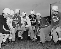 OSU (Ohio State University) football coach Woody Hayes with quarterback prospects on April 16, 1952. (Columbus Dispatch photo)