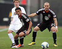 Andy Najar (14) and Branden Barklage (24) of D.C. United beat Ari Dimas (19)  during a scrimmage against the University of Virginia at Ludwig Field, University of Maryland, College Park, on April  10 2011. D.C. United won 1-0.