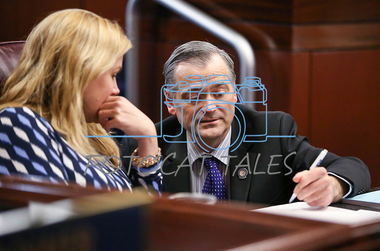 Nevada Senate Republicans James Settelmeyer and Patricia Farley work on the Senate floor at the Legislative Building in Carson City, Nev., on Tuesday, April 7, 2015. <br /> Photo by Cathleen Allison