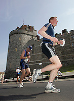 11JUN 2006 - WINDSOR, GBR - Competitors run past Windsor Castle during the Windsor Triathlon (PHOTO (C NIGEL FARROW)